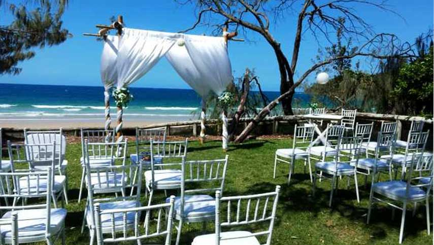 bamboo wedding arbor with loose fabric