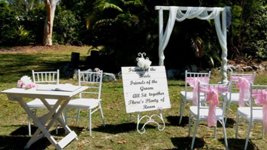 white wooden wedding arbor package
