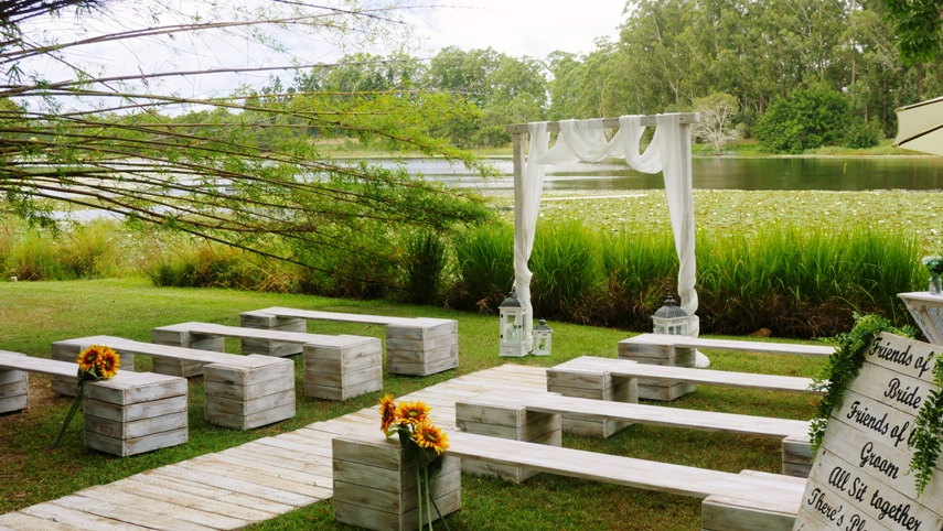 white washed benches for wedding